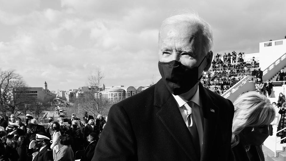 A black-and-white photo shows President Joe Biden and First Lady Jill Biden leaving the inauguration dais.