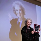 Margaret Atwood standing on a stage.
