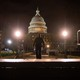 A police officer walks through the grounds of the U.S. Capitol on the night of January 6, hours after the insurrection.