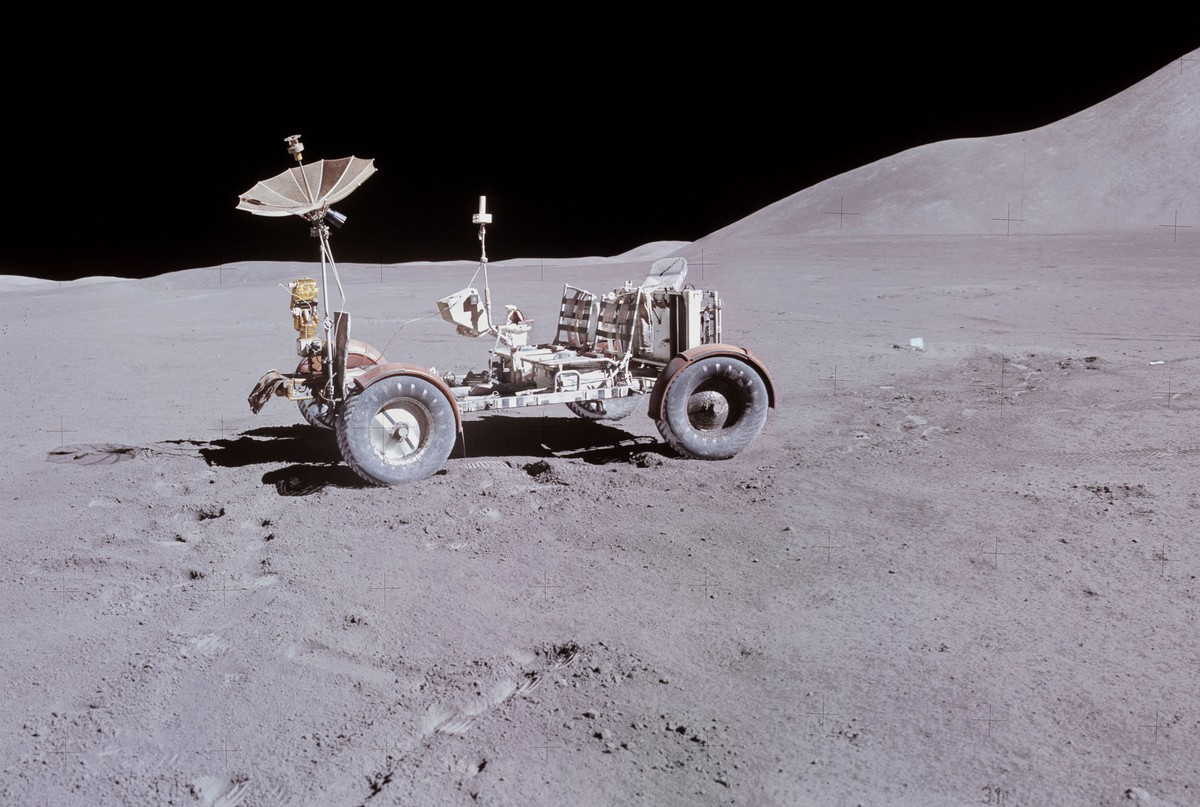 A lunar rover is seen parked on the lunar surface.