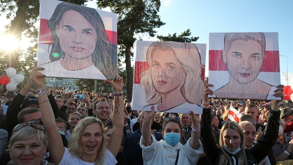 Women hold portraits of Sviatlana Tsikhanouskaya, Veronika Tsepkalo and Maria Kolesnikova at rally in support of Belarusian presidential candidatese Sviatlana Tsikhanouskaya.