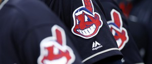 Members of the Cleveland Indians wear uniforms featuring mascot Chief Wahoo.