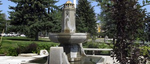 Photo of a public fountain monument in a park.