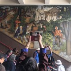 a photo of murals of George Washington's life and legacy inside San Francisco high school.