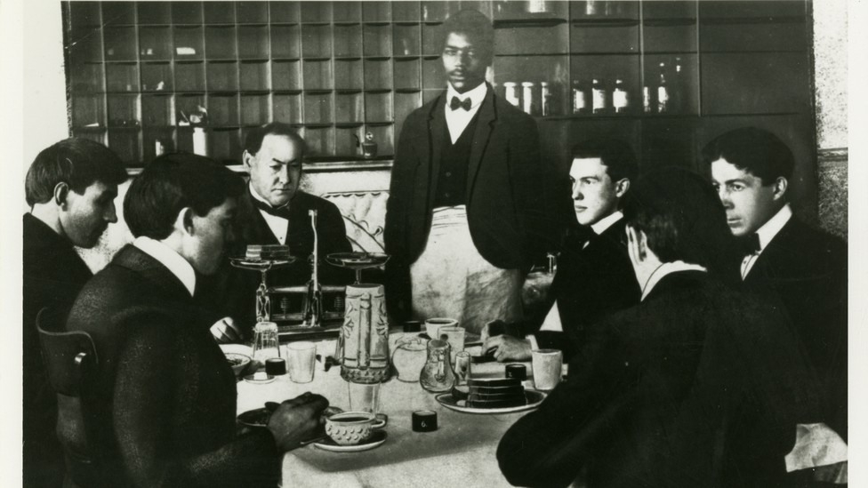 """A black-and-white photo of Harvey Wiley and members of the """"Poison Squad"""" eating a meal"""
