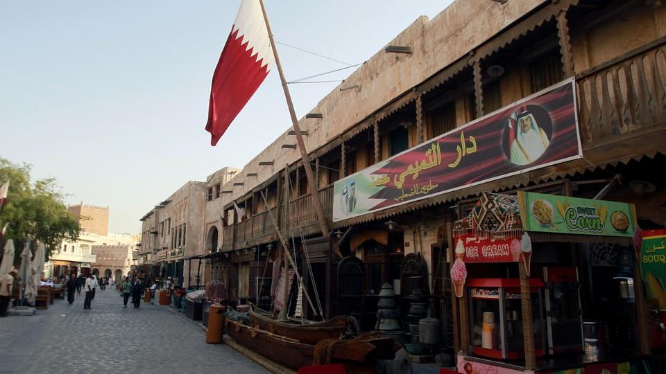 A shop with a picture of Qatar's Emir Sheikh Tamim Bin Hamad Al-Thani is seen in Doha, Qatar, June 6, 2017.