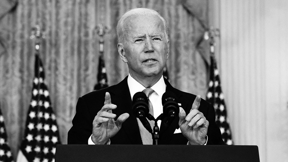 A black-and-white photo of Joe Biden as he delivers remarks about the situation in Afghanistan in the East Room of the White House