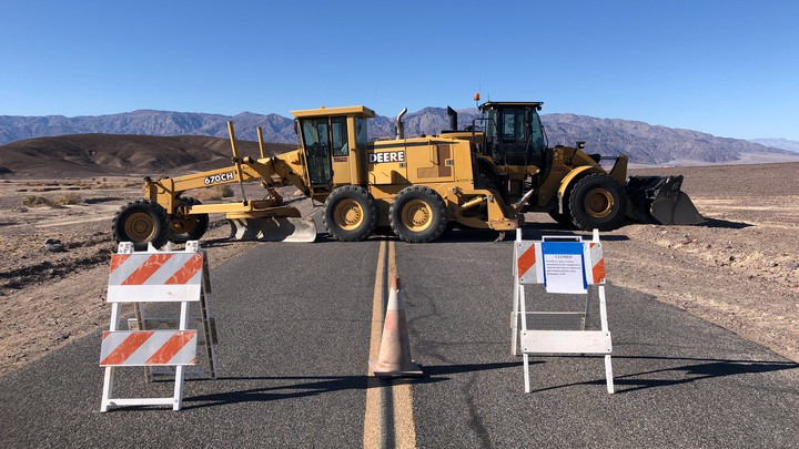 Construction vehicles block the entrance to part of Death Valley National Park.