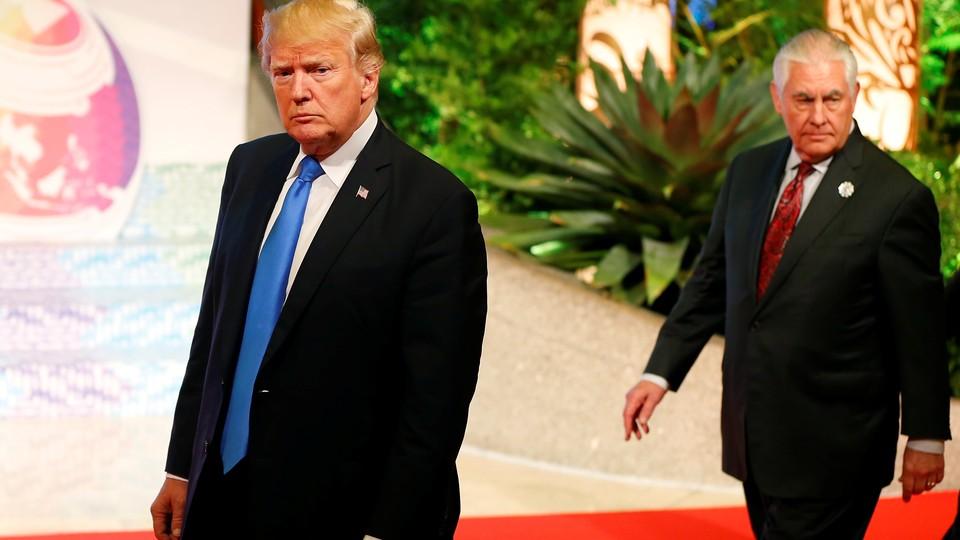 President Trump walks ahead of Secretary of State Rex Tillerson.