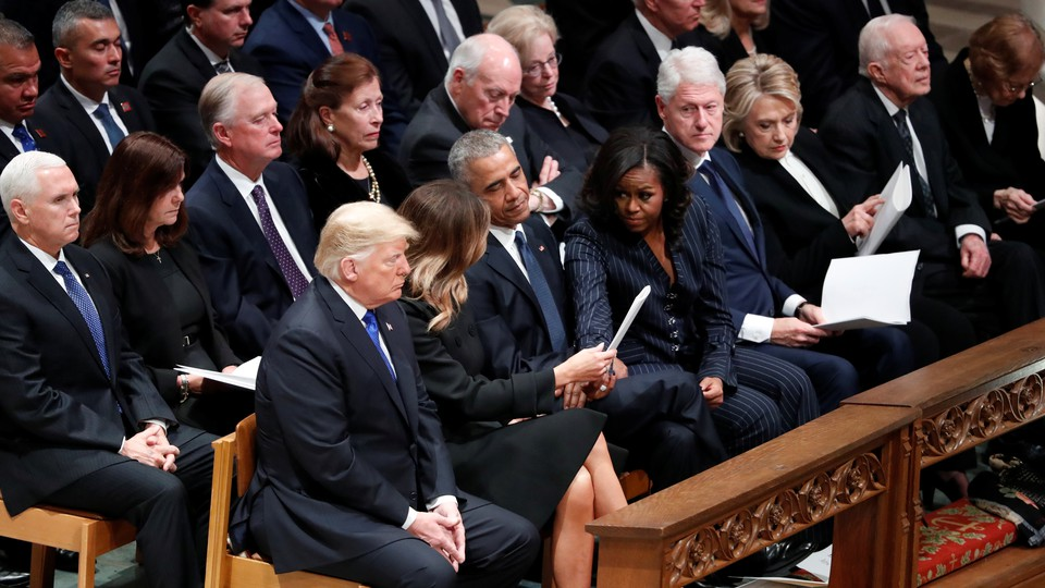 Donald and Melania Trump are seated next to Barack and Michelle Obama at George H. W. Bush's funeral.