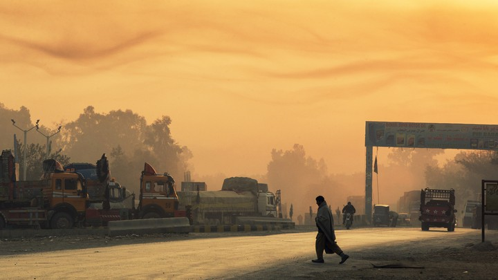 A man crosses the street near Forward Operating Base Fenty in Afghanistan's Nangarhar province on December 19, 2014.