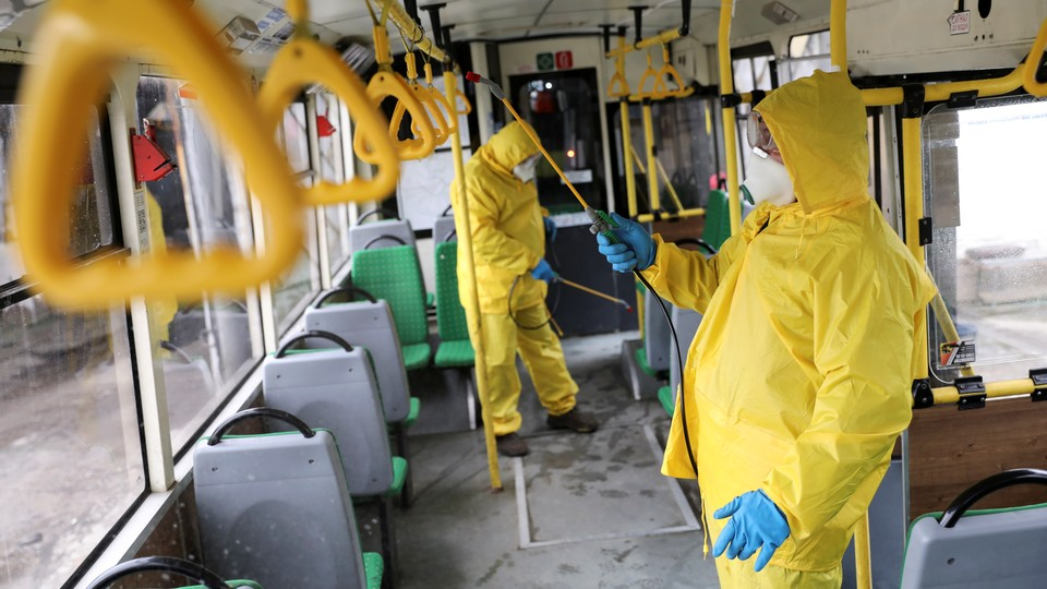 Workers sanitizing a bus in Ukraine.