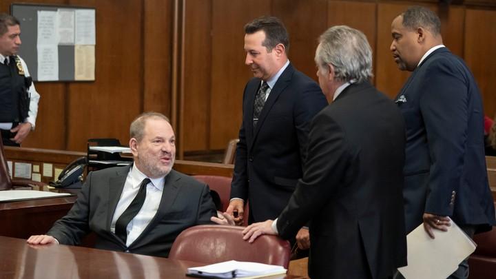 Film producer Harvey Weinstein with attorneys Jose Baez, Ronald S. Sullivan Jr., and Benjamin Brafman