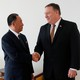 Kim Yong Chol and Mike Pompeo shaking hands