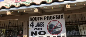 a photo of a local business displaying a protest sign of the proposed extension of the light rail system along Central Avenue, in Phoenix.