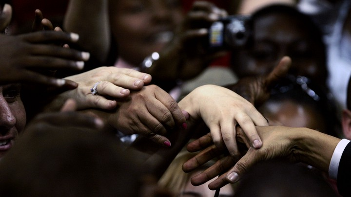 Supporters reach out to touch the hand of democratic presidential candidate Senator Obama