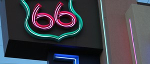 "A neon sign spells out ""66"" on historic Route 66."