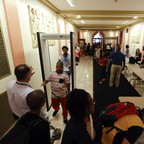 Students at William Hackett Middle School in Albany pass through metal detectors.