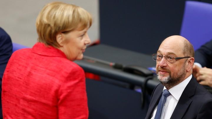 Chancellor Angela Merkel speaks with Martin Schulz.