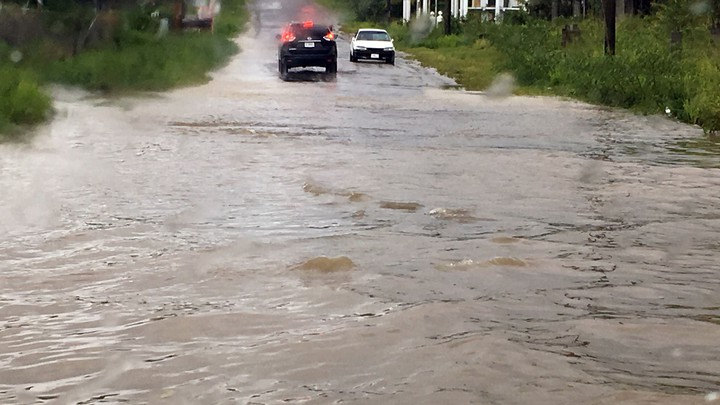Two cars are blocked by floodwaters from Hurricane Irma in St. John's, Antigua and Barbuda.