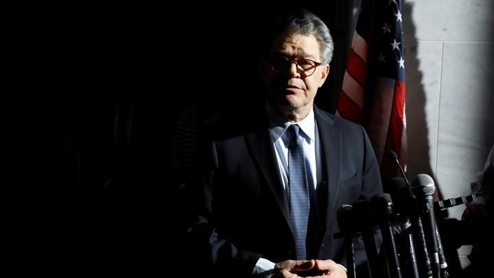 Senator Al Franken speaks to reporters outside his office in Washington on Monday.