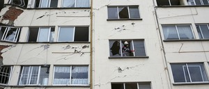 A rescue worker talks with others below as he stands inside an apartment building whose first four floors collapsed, in the Lindavista neighborhood of Mexico City on Wednesday, September 20, 2017.