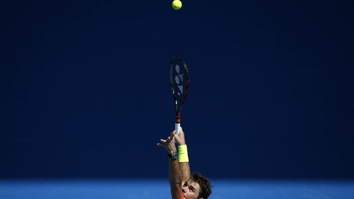 Stan Wawrinka delivering an overhead serve