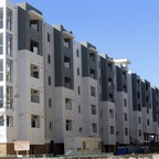A photo of an unfinished apartment building under construction in Torrance, California.