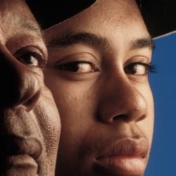 Portrait of golfer Tiger Woods with his father Earl Woods in 1992.