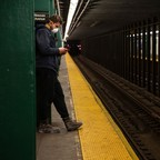 photo: A passenger in Brooklyn waits for a subway train.