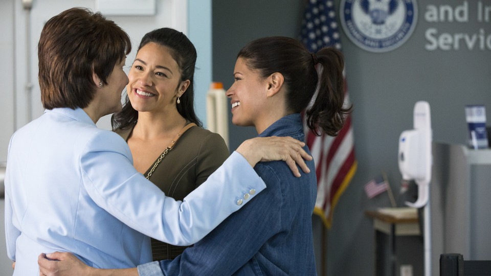 Alba (Ivonne Coll, left) celebrates after passing her U.S. citizenship test in Season 4 of 'Jane the Virgin'