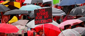 a photo of Los Angeles teachers holding a rally on the first day of their strike