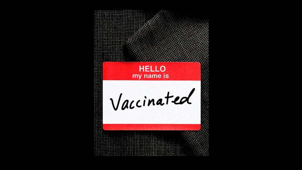 """A name tag that reads """"vaccinated"""""""