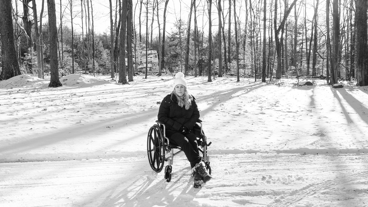 Photo of Caitlin Barber in wheelchair in snow
