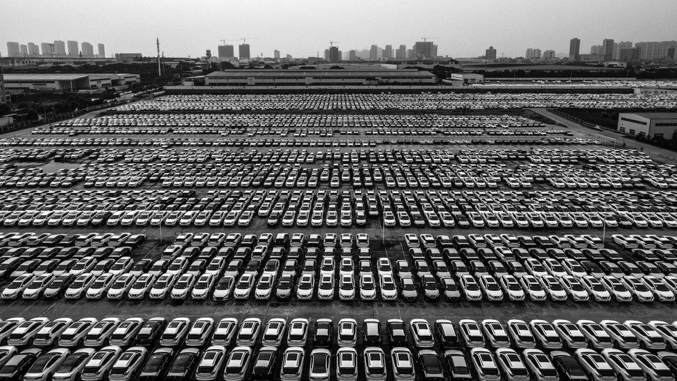 Aerial view of new Nissan vehicles sit parked at a parking lot in Xiangyang, Hubei Province of China