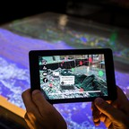 An augmented reality view of a city being used as an urban planning tool from MIT Media Lab.