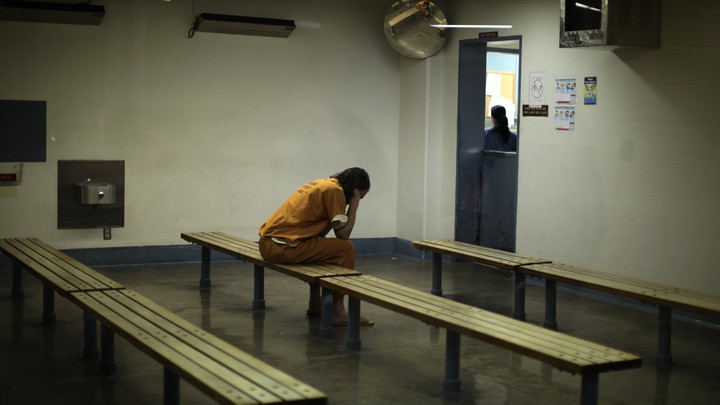 An unidentified inmate sits in a facility in Santa Ana, California.