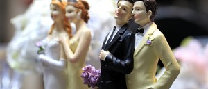Wedding-cake toppers of same-sex couples