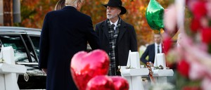Donald Trump shakes hands with Rabbi Jeffrey Myers at a cemetery in Pittsburgh.