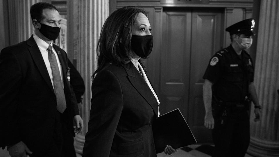 Kamala Harris walking through the halls of Congress.