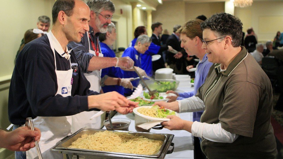 Maine's former governor John Baldacci, left, serves spaghetti at a fundraising event to benefit the Preble Street Resource Center, an agency that helps the homeless, in 2010.
