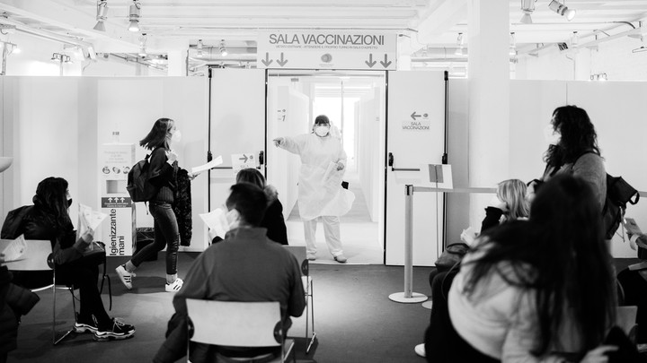 A nurse calls on patients waiting for the AstraZeneca COVID-19 vaccine at the Museum of Science and Technology in Milan, March 22.