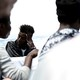 Migrants are pictured on the deck of the MV Aquarius in the central Mediterranean Sea onJune 12, 2018.