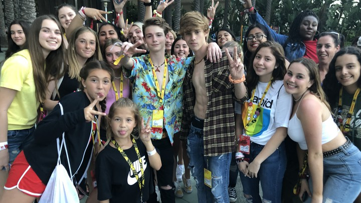 The TikTok stars Joe Waud and Payton Moormeier pose with fans at VidCon 2019.