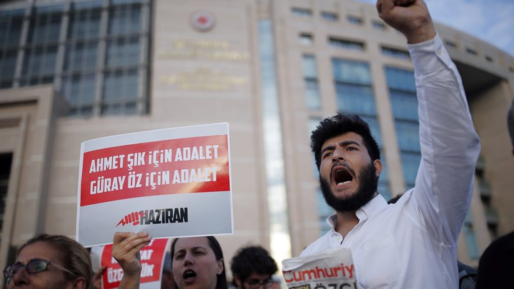 Journalists and activists gather outside an Istanbul court on July 28, 2017.