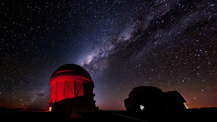 The Victor M. Blanco Telescope in Chile against a starry sky