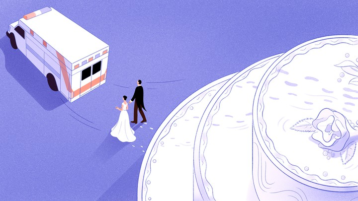 A man and a woman walk away from a cake and toward and an ambulance