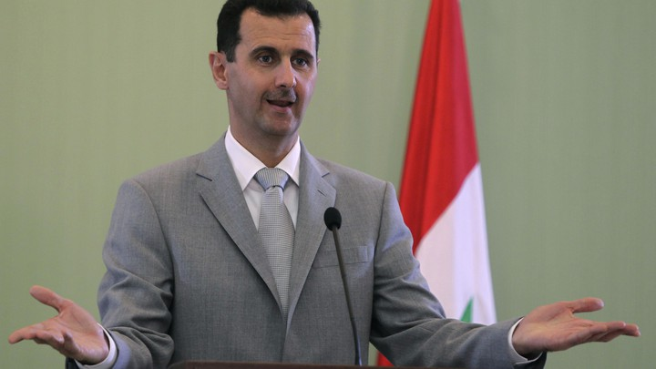Syria's President Bashar al-Assad gestures as he speaks during a news conference with Turkey's Prime Minister Tayyip Erdogan, after their meeting in Damascus October 11, 2010.