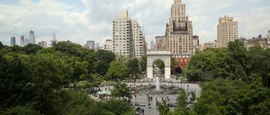 A view of Washington Square Park in New York with tall buildings beyond