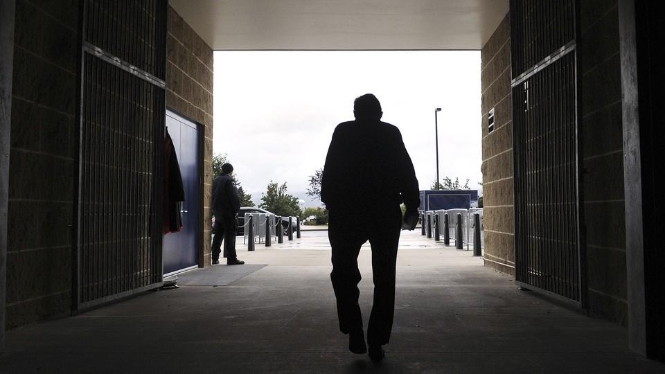 Former Penn State football coach Joe Paterno leaving Beaver Stadium